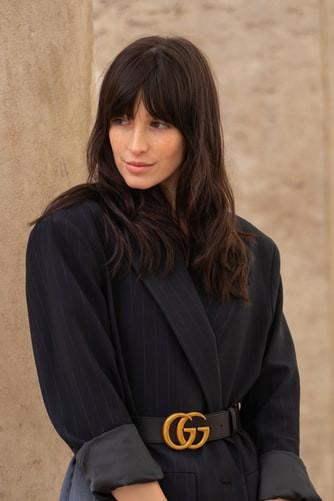 Woman wearing a blazer with gucci belt around her waist
