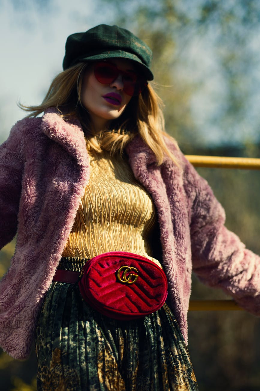 Woman wearing a fur coat and fanny pack
