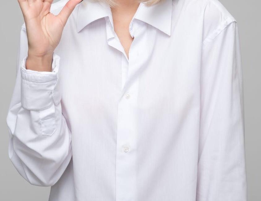 Woman wearing a white button-down shirt