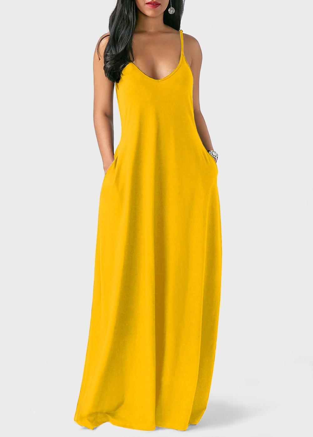 Woman wearing yellow spaghetti strap maxi dress from Roswe