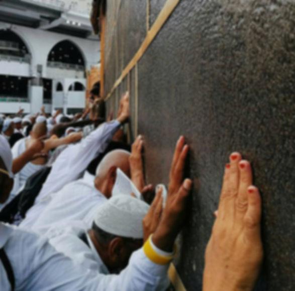 Touching the Kaaba Ibadah tours.jpeg