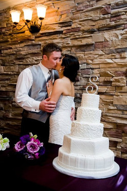 Couple kissing by the Cake