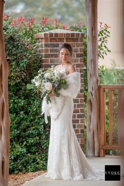 Beautiful bride by cottage