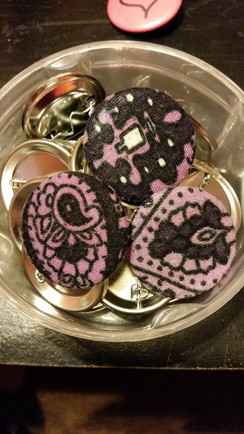 fabric from a favourite shirt turned into pinbacks