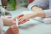 Woman hands receiving a manicure in beau
