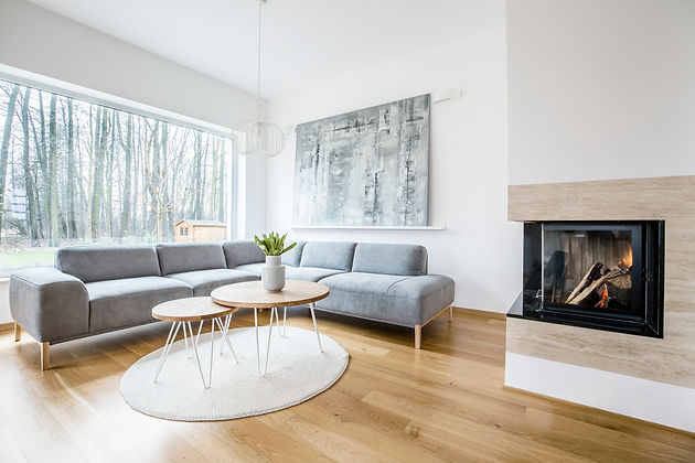 Canva - Living room interior with firepl