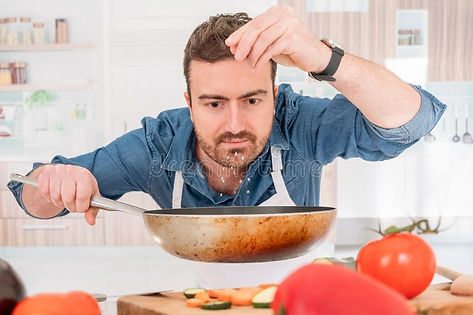 one-man-cooking-his-kitchen-adding-salt-cheerful-young-preparing-food-home-141104746.jpg