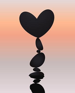 bigstock-Heart-And-Stone-Balancing-Roc-343896451_edited.jpg