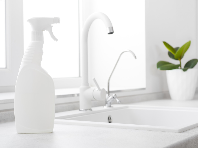 bigstock-Cleaning-Fluid-Bottle-On-Kitch-