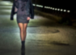 woman-standing-on-the-center-of-the-road