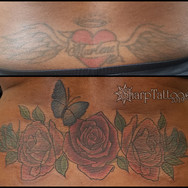 Covering an old tattoo with roses.