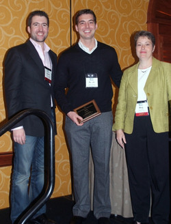 Aaron Garvey receives the Best Working Paper Award (co-author Lisa Bolton couldn't make it)