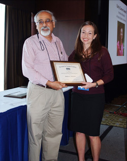 Andrea Morales receives the Early Career Award