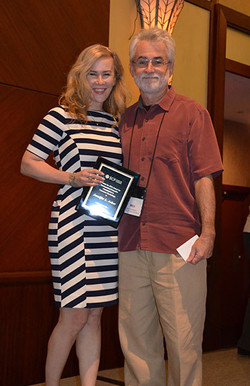Wes Hitchinson presents Jennifer Aaker with the SCP Distinguished Scientific Contribution Award