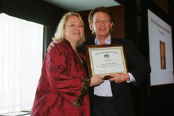 Tina Kiesler gets a plaque for chairing the 2010 summer SCP Conference