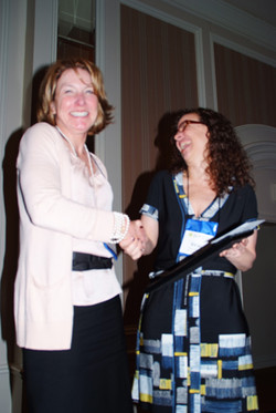 Wendy Wood accepts the Park Outstanding Contributor Award from SCP President, Vicki Morwitz