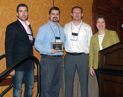 Jeff Parker and Rom Schrift (with Adam and Meg) receiving the Best Student Paper Award