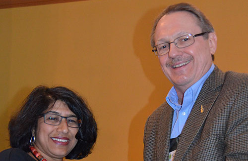 Rick Lutz presents Aradhna Krishna with her SCP Fellow Award