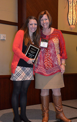 June Cotte presents Stephanie Tully the award for the SCP Dissertation Proposal Competition