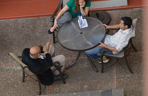 Research discussions outdoors at the hotel