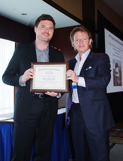 Martin Reimann receives the JCP Young Contributor Award