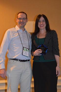 Stijn present the SCP Early Career Contribution Award to Rebecca Reczek
