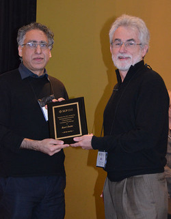 Wes Hutchinson presents Ravi Dhar with the SCP Distinguished Scientific Contribution Award