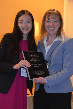 Susan presents Irene (Xun) Huang the 2014 Park JCP Young Contributor Award