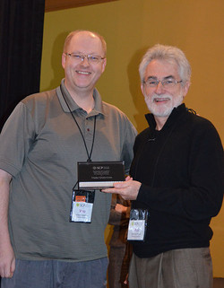 Wes Hutchinson presents Vladas Griskevicius with the Early Career Contribution Award