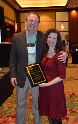 Rich Lutz presents Vikci Morwitz with her SCP Fellow Award