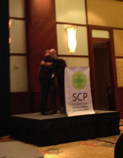 Hard to see in the dark setting, but Mark and Americus give Paul a hug after his talk