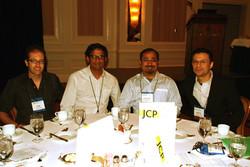 This year's conference chairs, Amitav Chakravarti and Anirban Mukhopadhyay, alongside next year's co