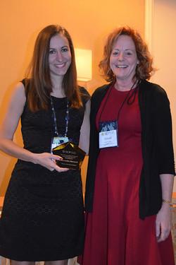 Joann Peck presents Alixandra Barasch the SCP Dissertation Proposal Competition winner's plaque