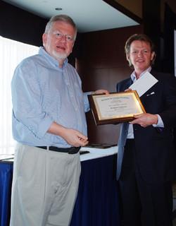 Norbert Schwarz receiving a plaque for Park JCP Award runner-up