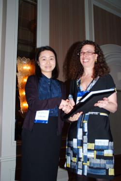 Ji Kyung Park receives the Park Young Contributor award from Vicki Morwitz