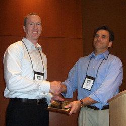 Peter McGraw received the conference Best Competitive Paper Award
