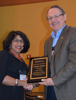 Rich Lutz presents Aradhna Krishna with her SCP Fellow Award