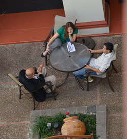 Research discussions outdoors at the hot