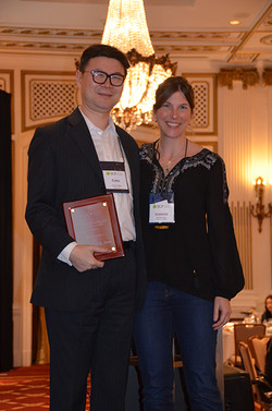 Jennifer presents Christopher Hsee with