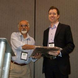 Rajiv Batra presented Zak Tormala the Early Career Award