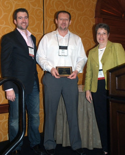Rom gets to hang around on the podium for his Conference Best Competitive Paper Award