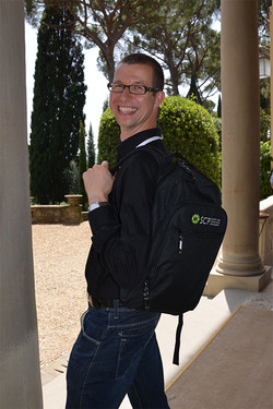 Stefano models the backpack he commissioned for every conference attendee.jpg