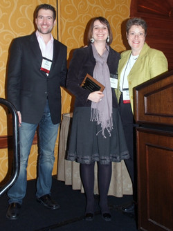 Helene Deval with Meg and Adam receiving a Dissertation Proposal Honorable Mention