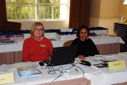 Patty Salo Downs and Rashmi Adaval helping people to check in