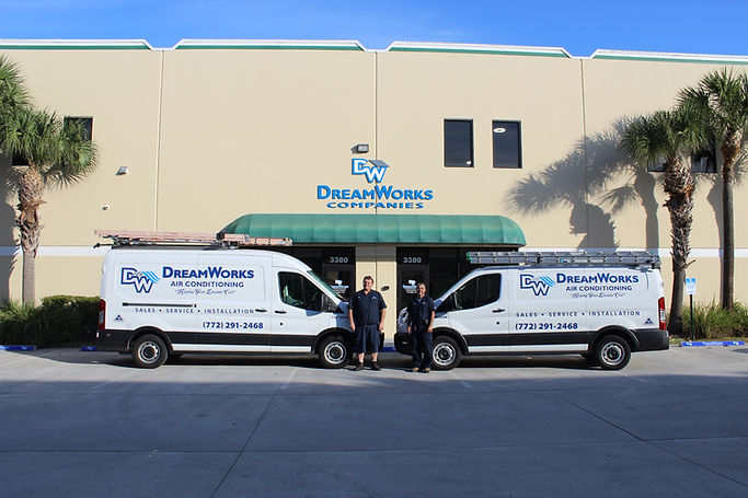Jeff & Danny from DWAC in Palm City, Florida, standing in front of their vans in front of the DW Companies Showroom.