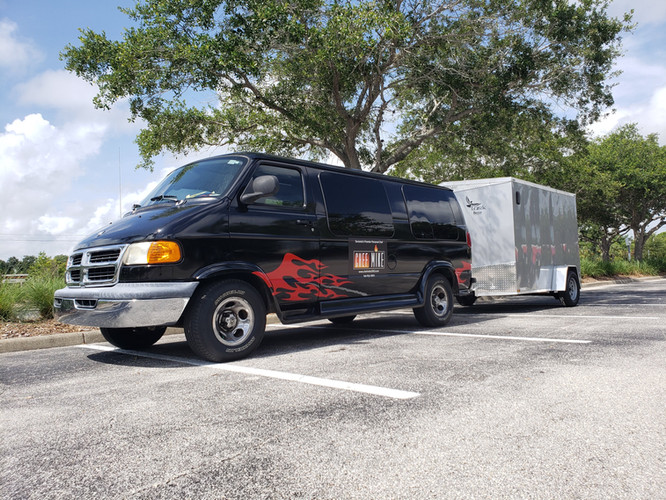 Chef Mike and his team arrive in a large black van and trailer.