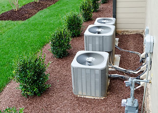 Outdoor AC Units next to a manicured lawn