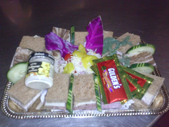 Little sandwiches and condiments made for an aircraft catering service.