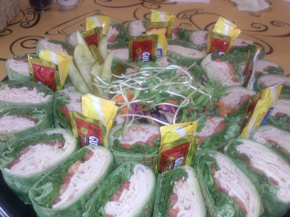 Chicken wraps prepared for a business event.