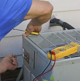 Man working on an outdoor AC unit